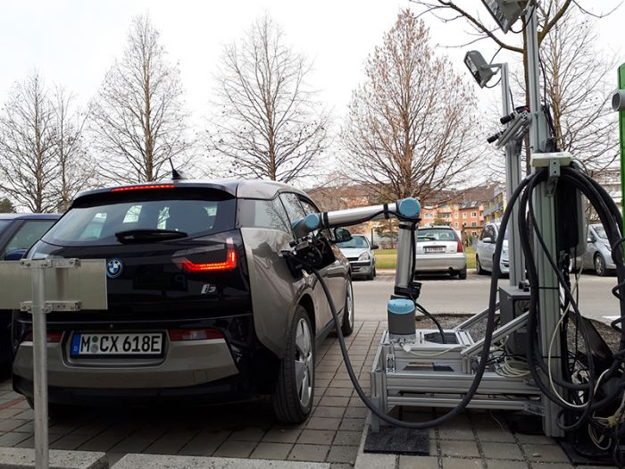 Robotic system for recharging EVs